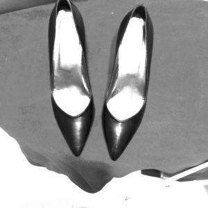 Versani pump with an exceptional heel.  8.5